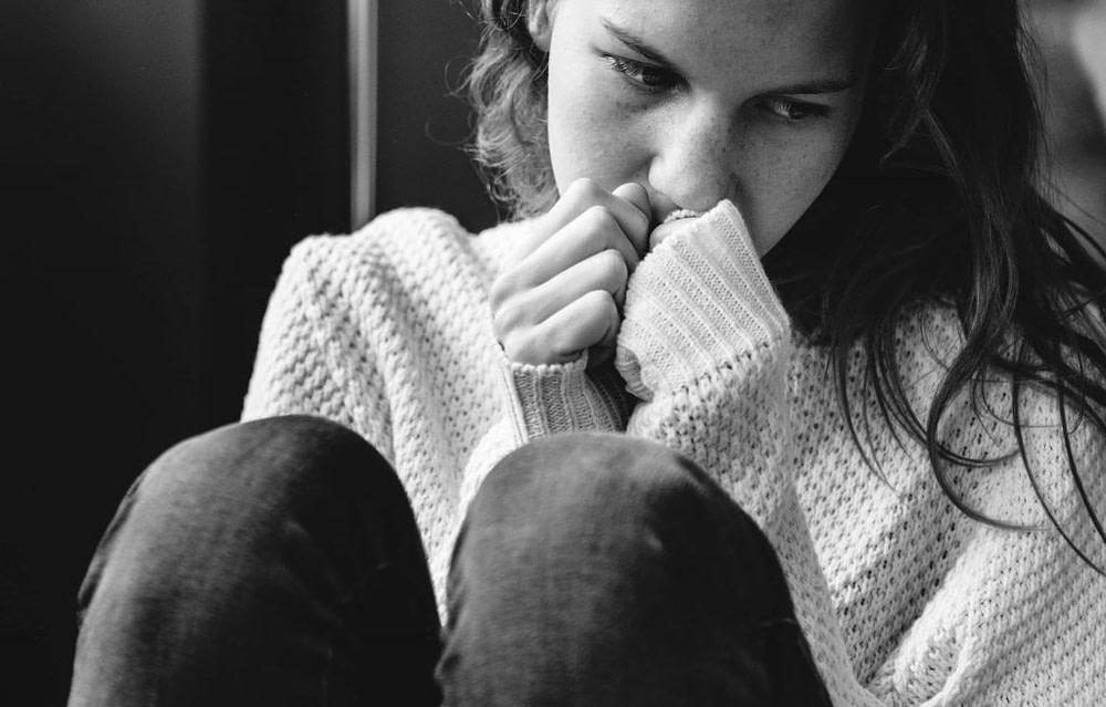 Young alone girl feeling sad